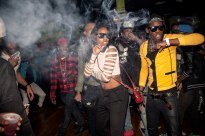 March 22nd, 2013. East Flatbush, Brooklyn. The Flavor Essence dance team moves through its choreography in unison as smoke clouds the air in a nightclub around 3am on a Thursday night. Videographers often attend the parties to make video of the dancers, which will be published on the internet on various websites that cater to the subculture. Teams often compete fiercely for the videographer's spotlight. (Natalie Keyssar)