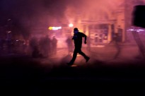 April 28th, 2015. Baltimore, Maryland. Police shoot tear gas to clear the street. Protesters, media, police and national guard converged near the corner of North and Pennsylvania Avenue in West Baltimore during protests on the evening of April 28th. For most of the day the protests consisted of dancing, singing, conversation and peaceful marching, but the night concluded with the use of tear gas to disperse a handful of protesters who didnt leave at the start of the curfew. Protests have rocked the city of Baltimore after the death of 25 year old resident Freddie Gray while in police custody due to a spinal injury. While the majority of protests have been completely peaceful, a few riots have broken out which police and national guard have responded to with arrests and dispersals of tear gas.