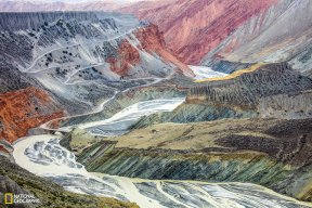 As the largest mountain ranges in Central Asia, Tian-shan ('sky-mountain' in Chinese), has one of the best collections of natural landscapes in the world and is seen by many as a paradise for outdoor adventures. Thanks to the richness of sediments compounded with the power of erosion by rivers flowing down the mountains, the north face of Tian-shan is carved into stunning plateaus and colorful canyons hundreds of meters deep, resulting in this surrealist painting in nature.